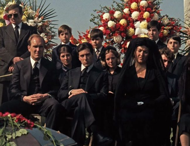 Michael-Corleone-siting-next-to-his-fath