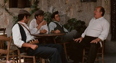 Michael Corleone and companions talking to Vitelli