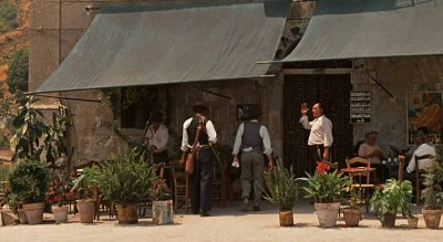 Michael Corleone and his companions arriving at Bar Vitelli