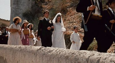 Michael and Apollonia walking with weding party