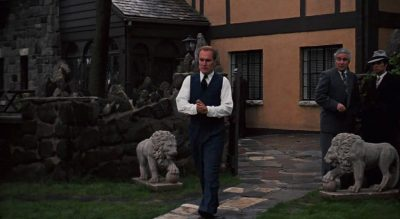 Tom Hagen coming out of the Corleone house - movieworldmap.com