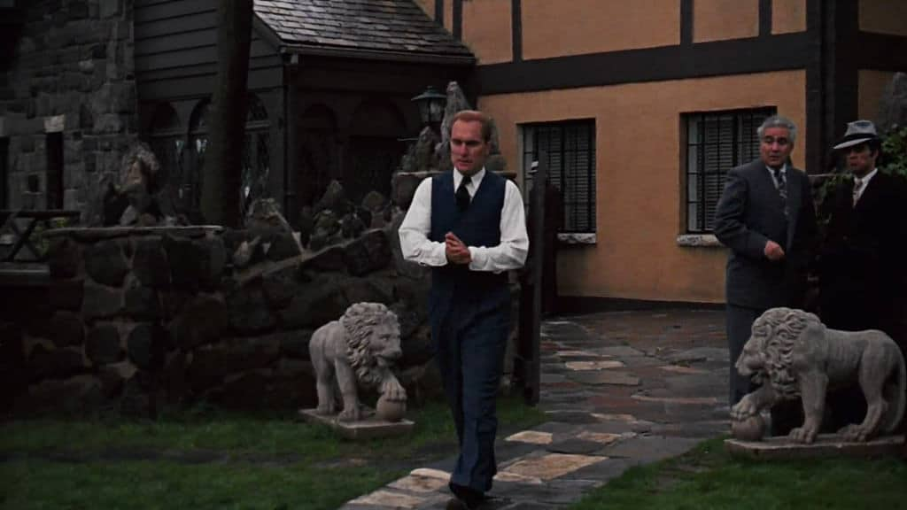 Tom-Hagen-coming-out-of-the-Corleone-house-movieworldmap.com_ Corleone Compound House Plans on