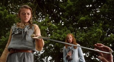 Arya points a sword towards Joffrey after Nymeria bits him in his arm and disarms him